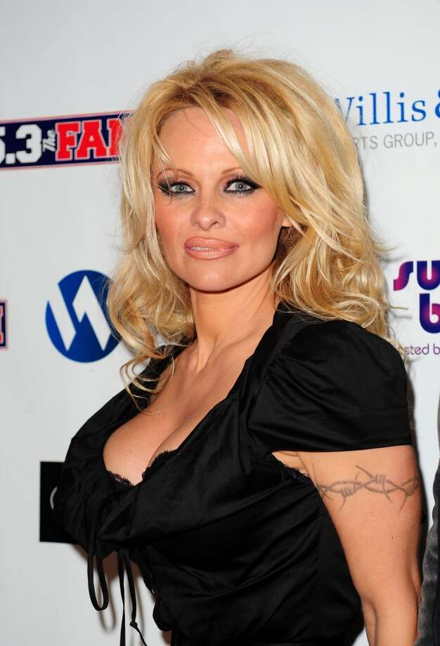 So, do how do you like Pamela Anderson's new, ''toned-down'' look? She's pictured here in 2011.