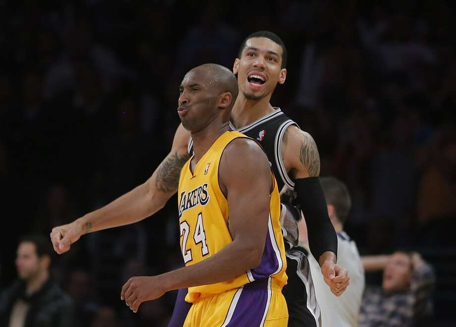 The Spurs\' Danny Green (right) reacts to his 3-point basket as he makes his way past Los Angeles Lakers\' Kobe Bryant in the second half in Los Angeles, Tuesday, Nov. 13, 2012. The Spurs won 84-82.