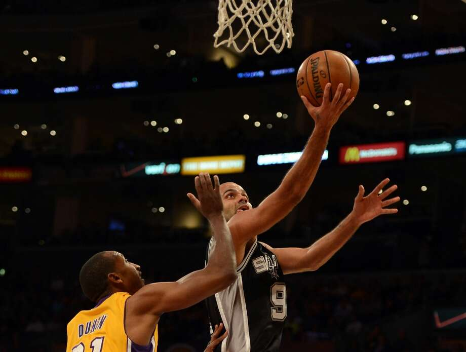 Tony Parker (9) of the Spurs scores on a layup past Chris Duhon (21) of the Los Angeles Lakers during a 84-82 Spurs win at Staples Center on Nov. 13, 2012 in Los Angeles.
