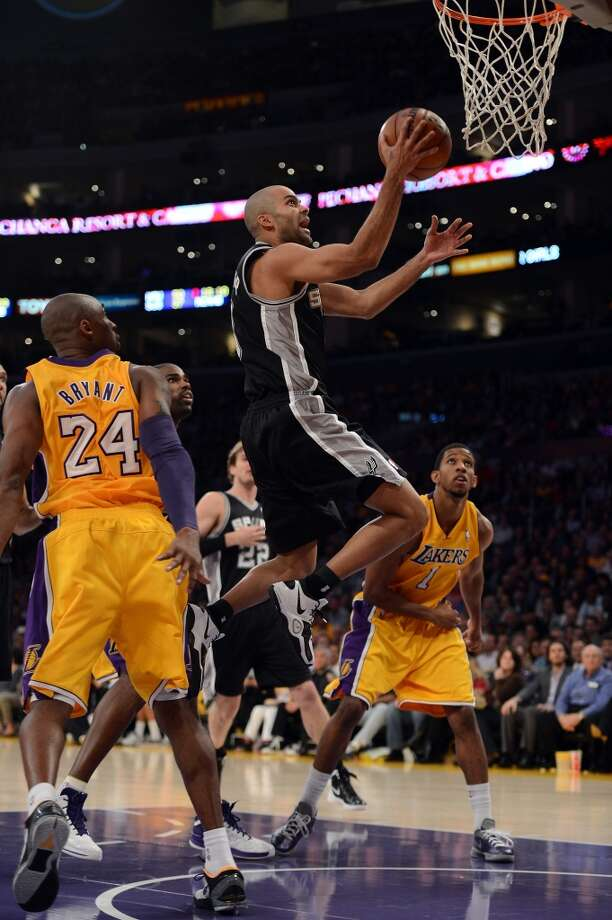 Tony Parker (9) of the Spurs scores on a layup past Kobe Bryant (24)  and Darius Morris (1) of the Los Angeles Lakers at Staples Center on Nov. 13, 2012 in Los Angeles.
