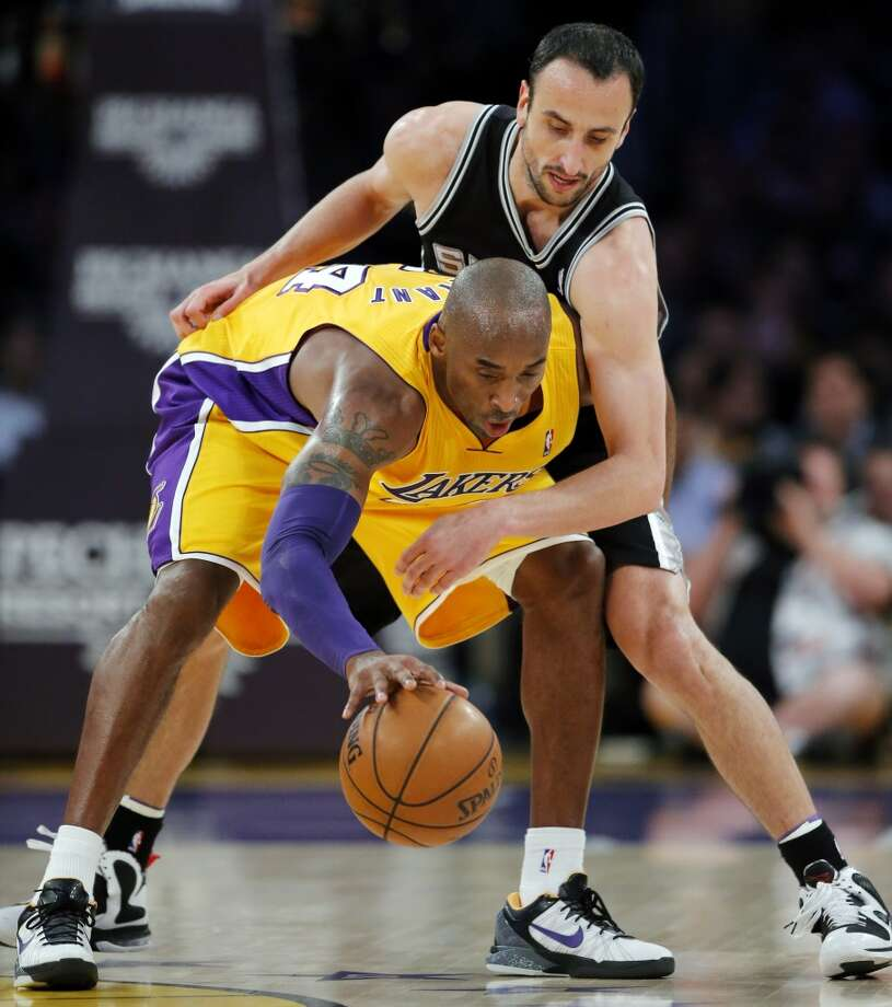 Los Angeles Lakers\' Kobe Bryant is defended by the Spurs\' Manu Ginobili (top) in the first half in Los Angeles, Tuesday, Nov. 13, 2012.