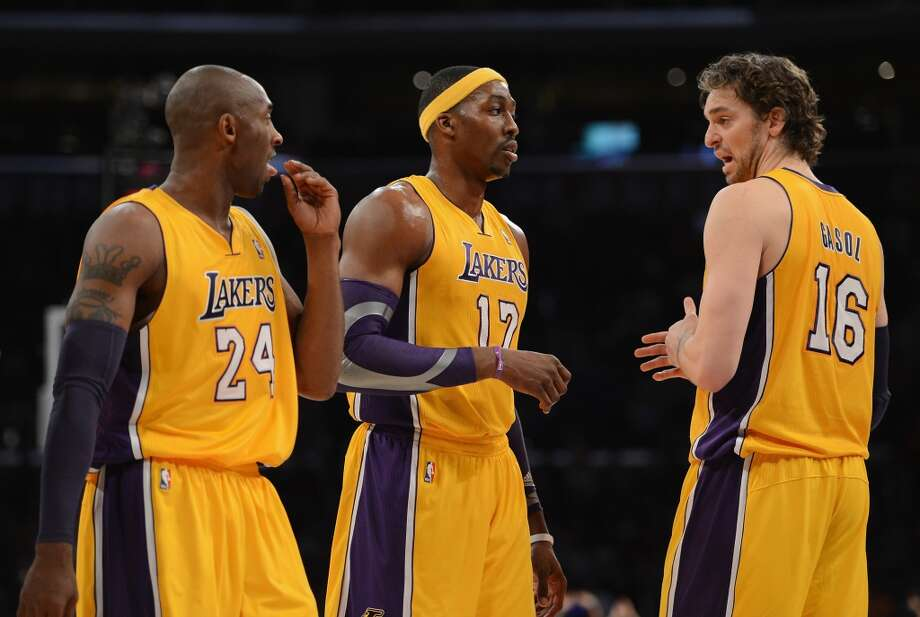 Kobe Bryant (24), Dwight Howard (12) and Pau Gasol (16) of the Los Angeles Lakers talk during the game against the Spurs at Staples Center on Nov. 13, 2012 in Los Angeles.