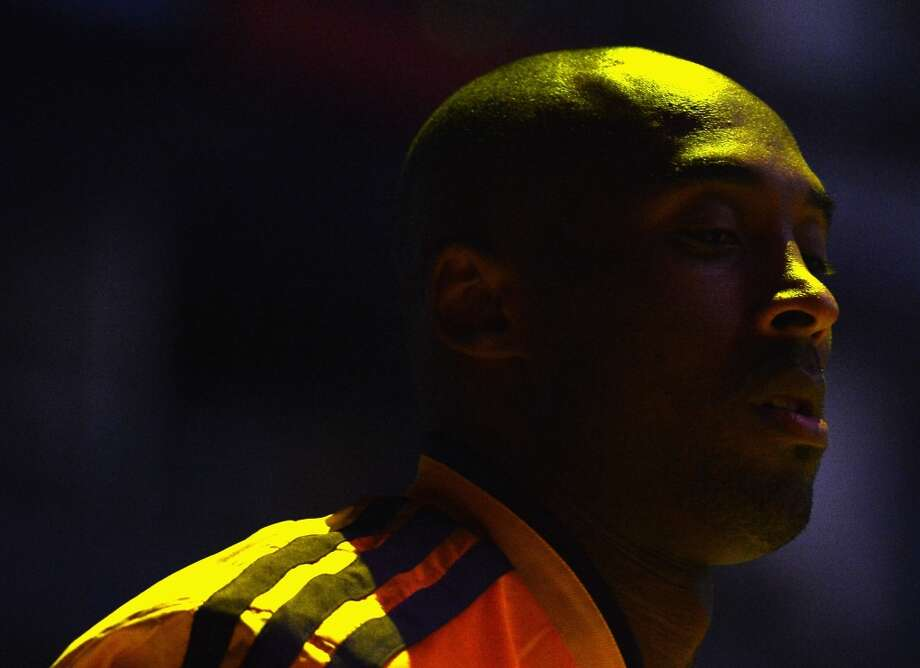 Kobe Bryant (24) of the Los Angeles Lakers walks on the court as he is introduced before the game against the Spurs at Staples Center on Nov. 13, 2012 in Los Angeles.