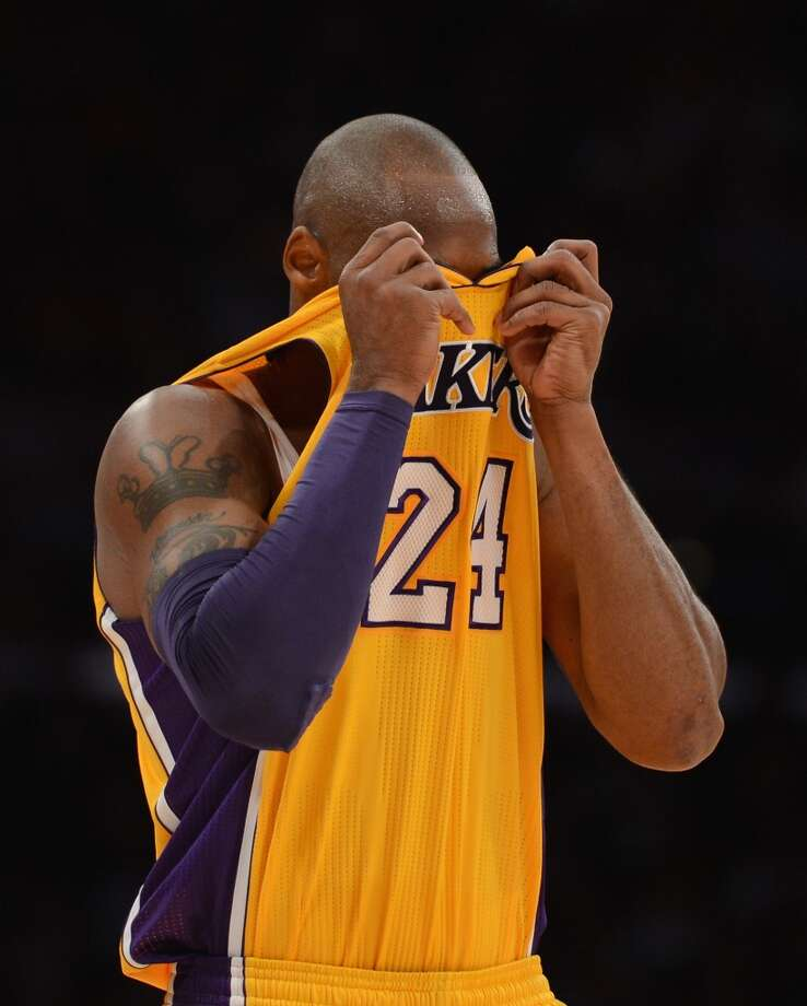 Kobe Bryant (24) of the Los Angeles Lakers reacts during the Spurs\' 84-82 victory at Staples Center on Nov. 13, 2012 in Los Angeles.