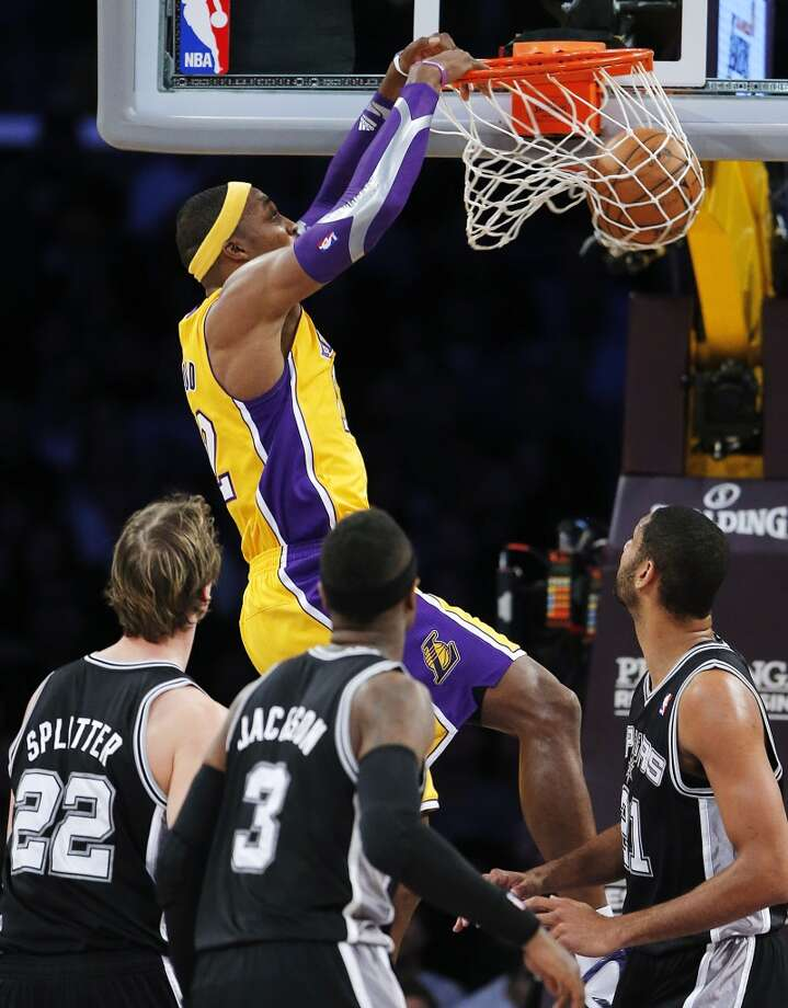 Los Angeles Lakers\' Dwight Howard (top) dunks as the Spurs\' Tiago Splitter (22), Stephen Jackson (3) and Tim Duncan watch in the first half in Los Angeles, Tuesday, Nov. 13, 2012.