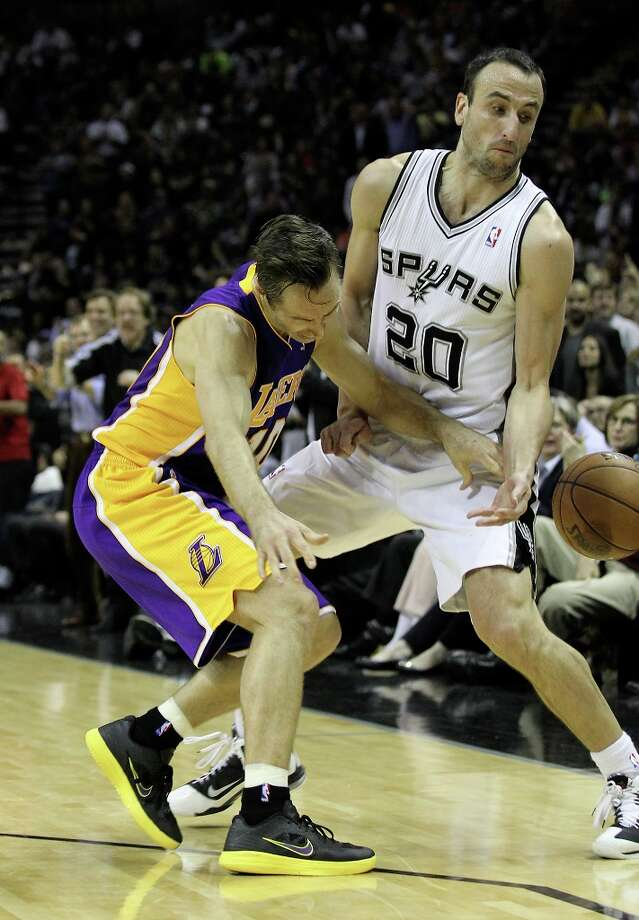 Spurs\' Manu Ginobili (20) attempts a steal against Los Angeles Lakers\' Steve Nash (10) in the first half at the AT&T Center on Wednesday, Jan. 9, 2013. Photo: Kin Man Hui, San Antonio Express-News / © 2012 San Antonio Express-News