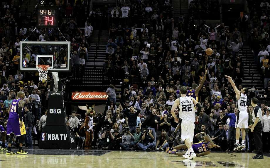 CORRECTION: Spurs\' Manu Ginobili (20) shoots a three-pointer late in the fourth over Los Angeles Lakers\' Antawn Jamison (04) in the second half at the AT&T Center on Wednesday, Jan. 9, 2013. Spurs defeated the Lakers, 108-105. Photo: Kin Man Hui, San Antonio Express-News / © 2012 San Antonio Express-News