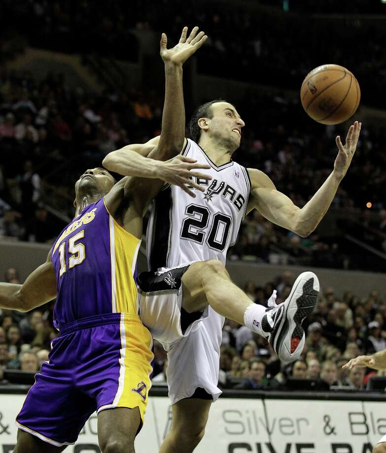 Spurs\' Manu Ginobili (20) tangles with Los Angeles Lakers\' Metta World Peace (15) for a rebound in the second half at the AT&T Center on Wednesday, Jan. 9, 2013. Spurs defeated the Lakers, 108-105. Photo: Kin Man Hui, San Antonio Express-News / © 2012 San Antonio Express-News