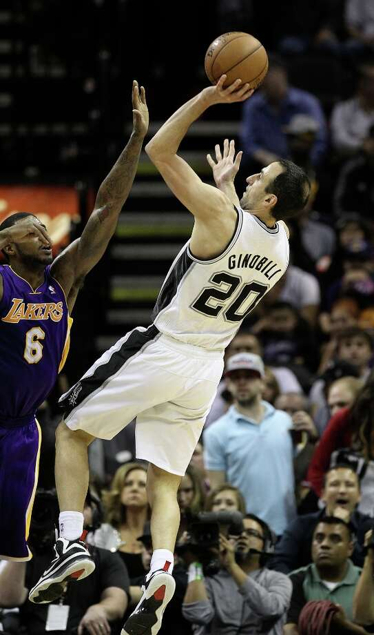 Spurs\' Manu Ginobili (20) shoots over Los Angeles Lakers\' Earl Clark (06) in the second half at the AT&T Center on Wednesday, Jan. 9, 2013. Spurs defeated the Lakers, 108-105. Photo: Kin Man Hui, San Antonio Express-News / © 2012 San Antonio Express-News