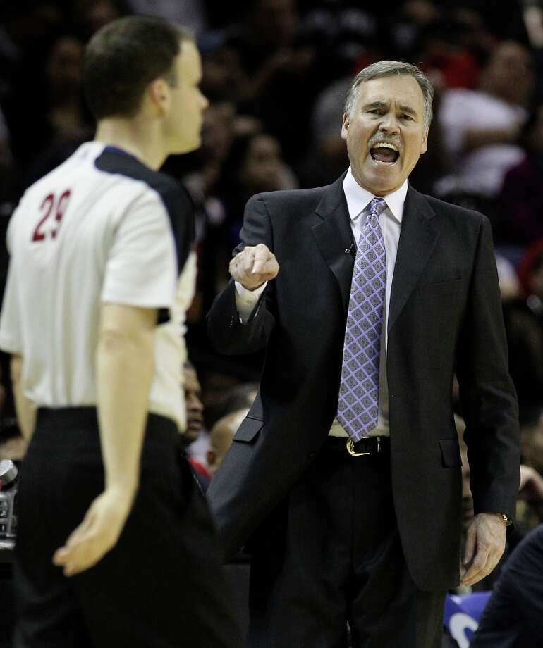 Los Angeles Lakers coach Mike D\'Antoni debates with game official Mark Lindsay in the second half at the AT&T Center on Wednesday, Jan. 9, 2013. Spurs defeated the Lakers, 108-105. Photo: Kin Man Hui, San Antonio Express-News / © 2012 San Antonio Express-News