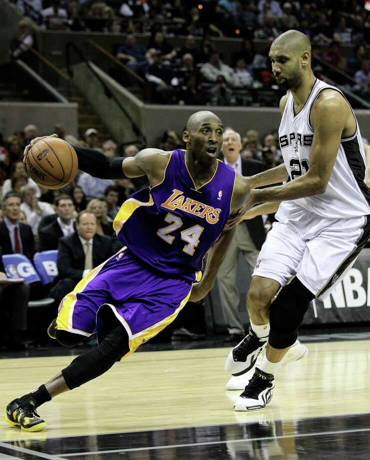 Spurs\' Tim Duncan (21) guards Los Angeles Lakers\' Kobe Bryant (24) in the second half at the AT&T Center on Wednesday, Jan. 9, 2013. Spurs defeated the Lakers, 108-105. Photo: Kin Man Hui, San Antonio Express-News / © 2012 San Antonio Express-News
