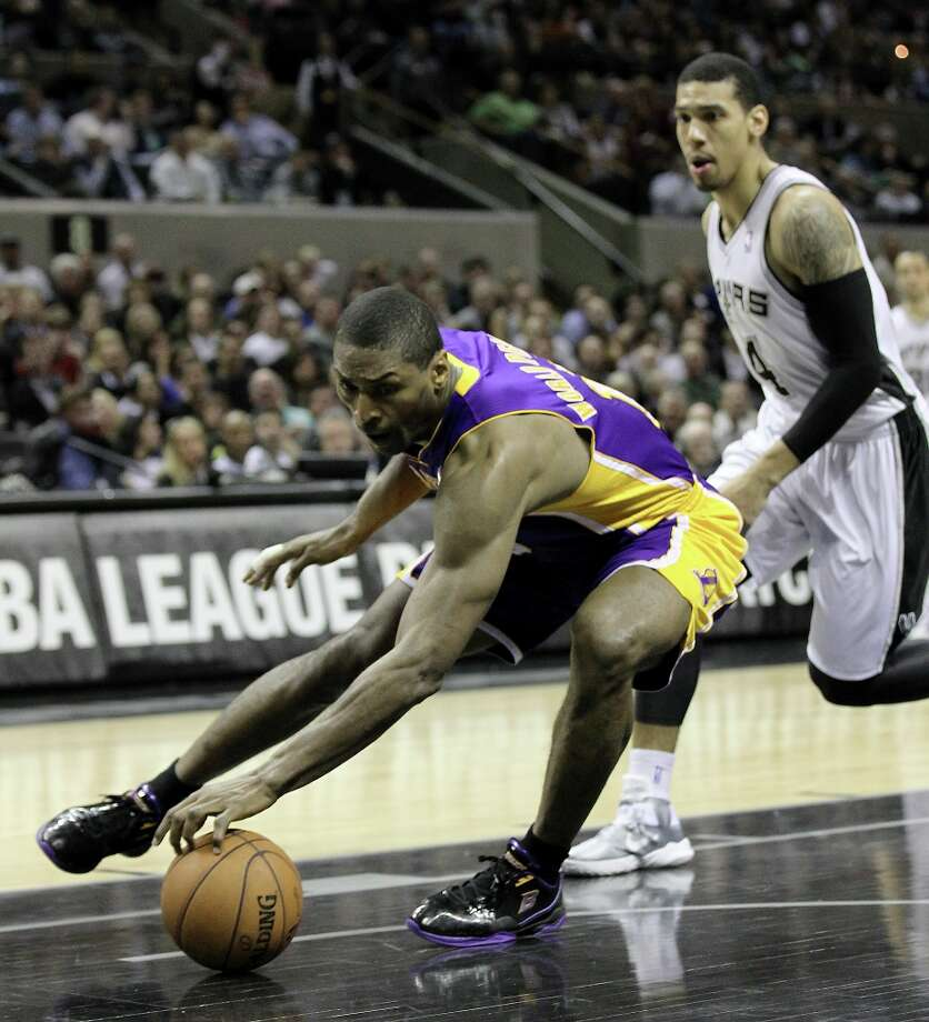 Los Angeles Lakers\' Metta World Peace (15) retrieves a loose ball against Spurs\' Danny Green (04) in the second half at the AT&T Center on Wednesday, Jan. 9, 2013. Spurs defeated the Lakers, 108-105. Photo: Kin Man Hui, San Antonio Express-News / © 2012 San Antonio Express-News