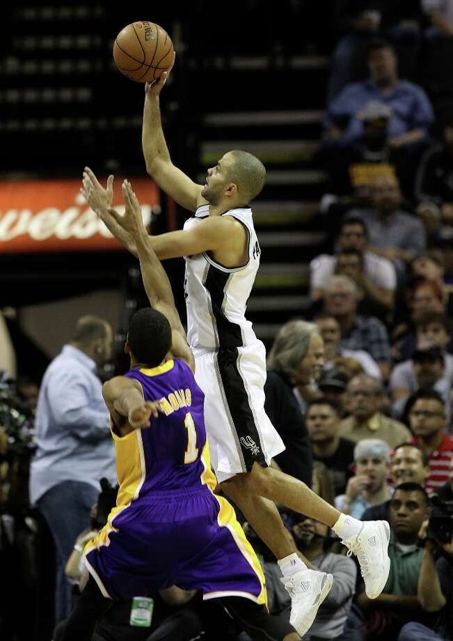 Spurs\' Tony Parker (09) goes for a shot against Los Angeles Lakers\' Darius Morris (01) in the second half at the AT&T Center on Wednesday, Jan. 9, 2013. Spurs defeated the Lakers, 108-105. Photo: Kin Man Hui, San Antonio Express-News / © 2012 San Antonio Express-News