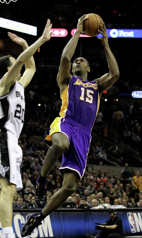 Los Angeles Lakers\' Metta World Peace (15) takes a shot against the Spurs\' Manu Ginobili (20) in the second half at the AT&T Center on Wednesday, Jan. 9, 2013. Spurs defeated the Lakers, 108-105. Photo: Kin Man Hui, San Antonio Express-News / © 2012 San Antonio Express-News
