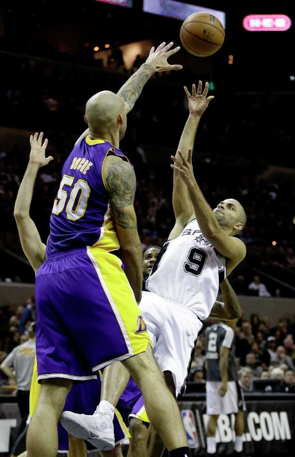 San Antonio Spurs\' Tony Parker (9), of France, shoots over Los Angeles Lakers\' Robert Sacre (50) during the first quarter of an NBA basketball game on Wednesday, Jan. 9, 2013, in San Antonio. Photo: Eric Gay, Associated Press / AP