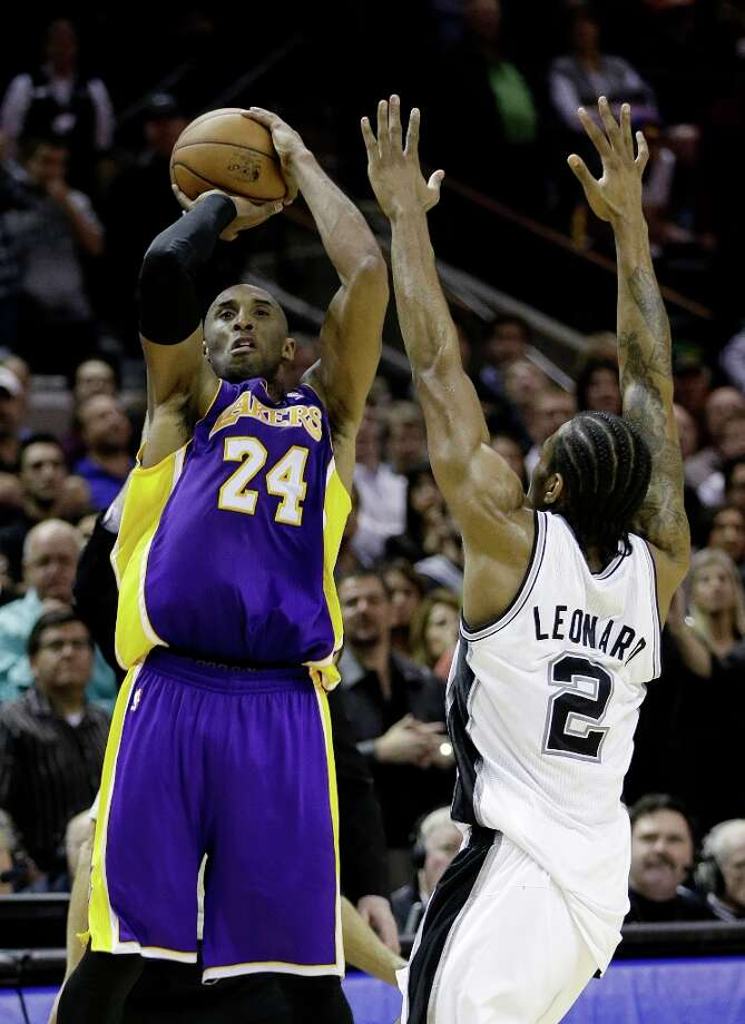 Los Angeles Lakers\' Kobe Bryant (24) shoots over San Antonio Spurs\' Kawhi Leonard (2)during the final seconds of the fourth quarter of an NBA basketball game on Wednesday, Jan. 9, 2013, in San Antonio. San Antonio won 108-105. Photo: Eric Gay, Associated Press / AP
