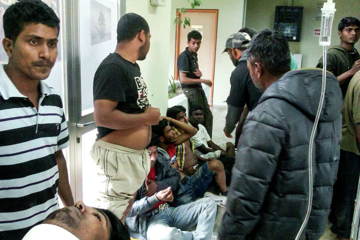 Migrant workers receive first aid in Greece. Migrant strawberry pickers were shot and wounded in a pay dispute when foremen opened fire on them with a shotgun, police say.