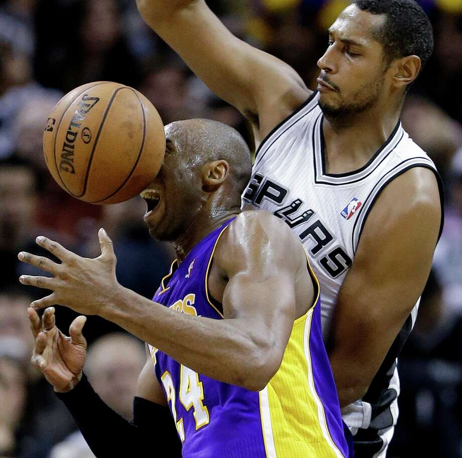 Los Angeles Lakers\' Kobe Bryant (24) loses control of the ball as he is defended by San Antonio Spurs\' Boris Diaw, right, of France, during the second quarter of an NBA basketball game on Wednesday, Jan. 9, 2013, in San Antonio. Photo: Eric Gay, Associated Press / AP