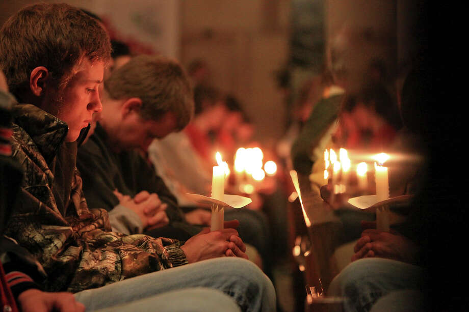 People pray,Thursday April 18, 2013, during a candlelight vigil at Church of the Assumption in West, Tx. for the explosion at a fertilizer plant that occurred Wednesday evening. Photo: Edward A. Ornelas, San Antonio Express-News / © 2013 San Antonio Express-News