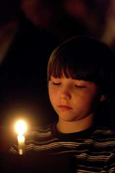 Clayton Tribble, 9, of West, attends the candlelight vigil. Photo: Johnny Hanson, Houston Chronicle / © 2013  Houston Chronicle