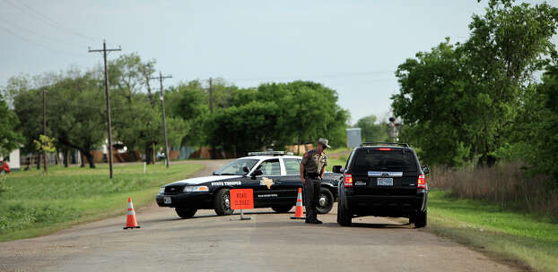 A Texas Department of Public Safety State Trooper blocks a street,  Thursday April 18, 2013, near the scene of an explosion at a fertilizer plant that occurred Wednesday evening in West, Tx. Photo: Edward A. Ornelas, San Antonio Express-News / © 2013 San Antonio Express-News