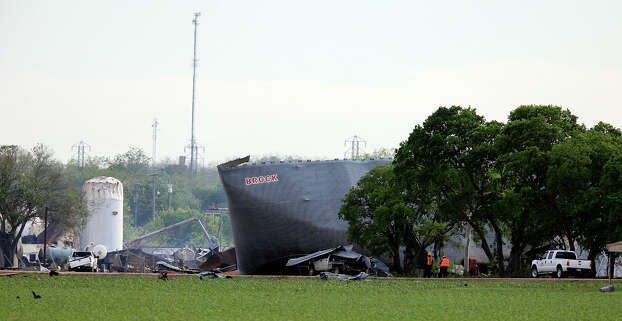 Workers examine the scene of an explosion, Thursday April 18, 2013, at a fertilizer plant, that occurred Wednesday evening in West, Tx. Photo: Edward A. Ornelas, San Antonio Express-News / © 2013 San Antonio Express-News