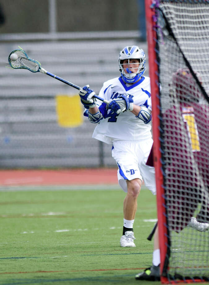 Darien's Kyle Cornell takes a shot during Thursday's lacrosse game against St. Joseph at Darien High School on April 18, 2013. Photo: Lindsay Perry / Stamford Advocate