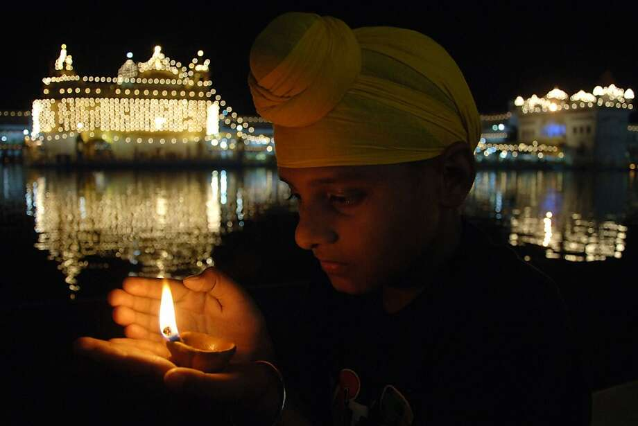 Birthday devotions:An Indian Sikh worshipper pays his respects at the Golden Temple in Amritsar on the 392nd birth anniversary of the ninth Sikh Guru, Teg Bahadur. Photo: Narinder Nanu, AFP/Getty Images