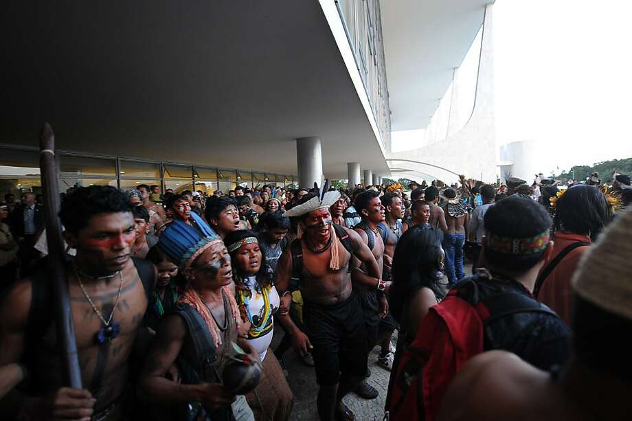 Hundreds of Brazilian natives occupy the entrance to the Planalto Palace protesting against the Proposed Aamendment to the Constitution (PEC) 215, which gives the National Congress the power to demarcate indigenous lands, in Brasilia, on April 16, 2013. AFP PHOTO / Evaristo SAEVARISTO SA/AFP/Getty Images Photo: Evaristo Sa, AFP/Getty Images