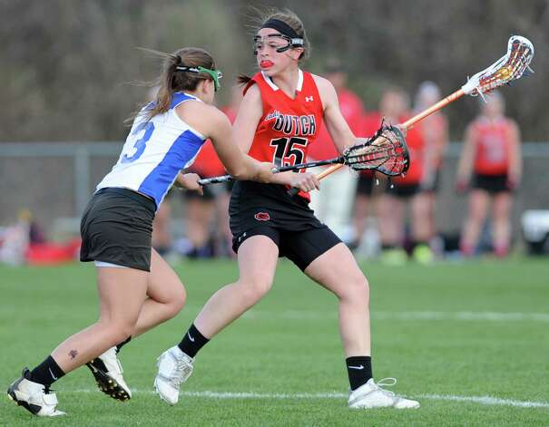 From left, Shaker's Lynn Roberts tries to defend Guilderland's Cara Quimby during a lacrosse game on Thursday, April 18, 2013 in Latham, N.Y.  (Lori Van Buren / Times Union) Photo: Lori Van Buren