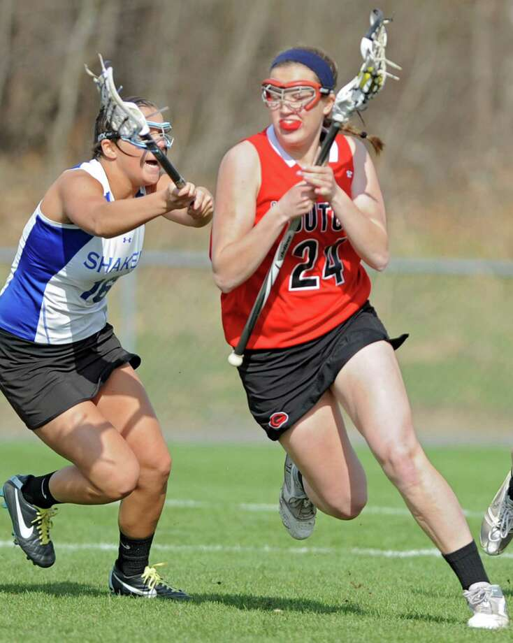 From left, Shaker's Casey Terzian tries to defends Guilderland's Rebecca Golderman but Golderman scores on this drive during a lacrosse game on Thursday, April 18, 2013 in Latham, N.Y.  (Lori Van Buren / Times Union) Photo: Lori Van Buren