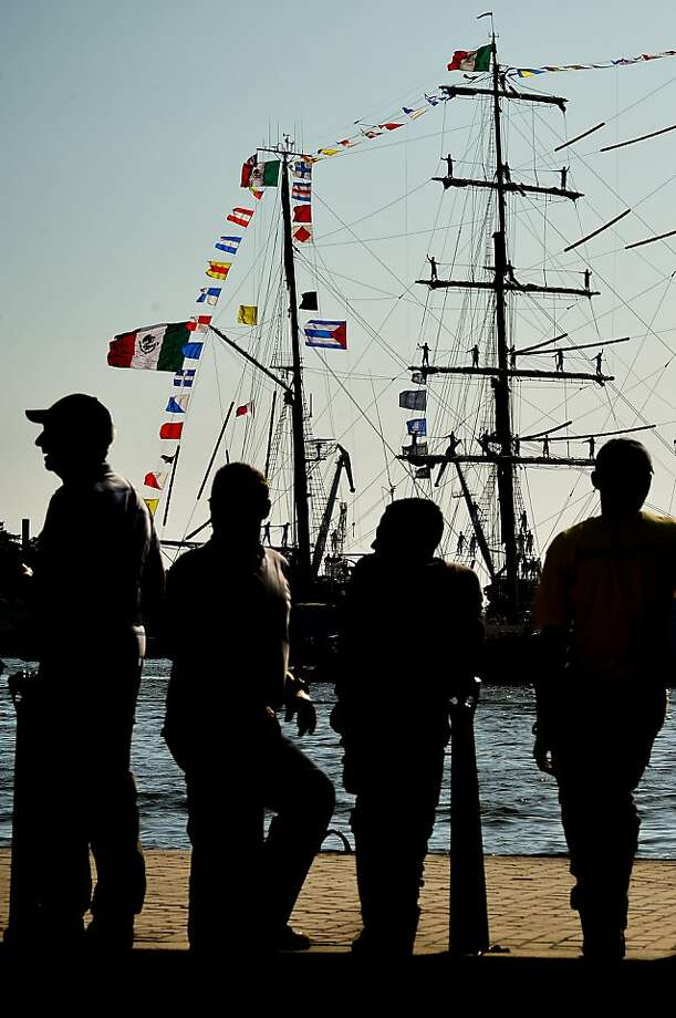 Cuban people look at the arrival of the sail training vessel of the Mexican Army, ARM Cuauhtemoc, to Havana Harbour on April 18, 2013. The Cuauhtemoc is in Cuba in a four-day official visit.       AFP PHOTO/Adalberto RoqueADALBERTO ROQUE/AFP/Getty Images Photo: Adalberto Roque, AFP/Getty Images