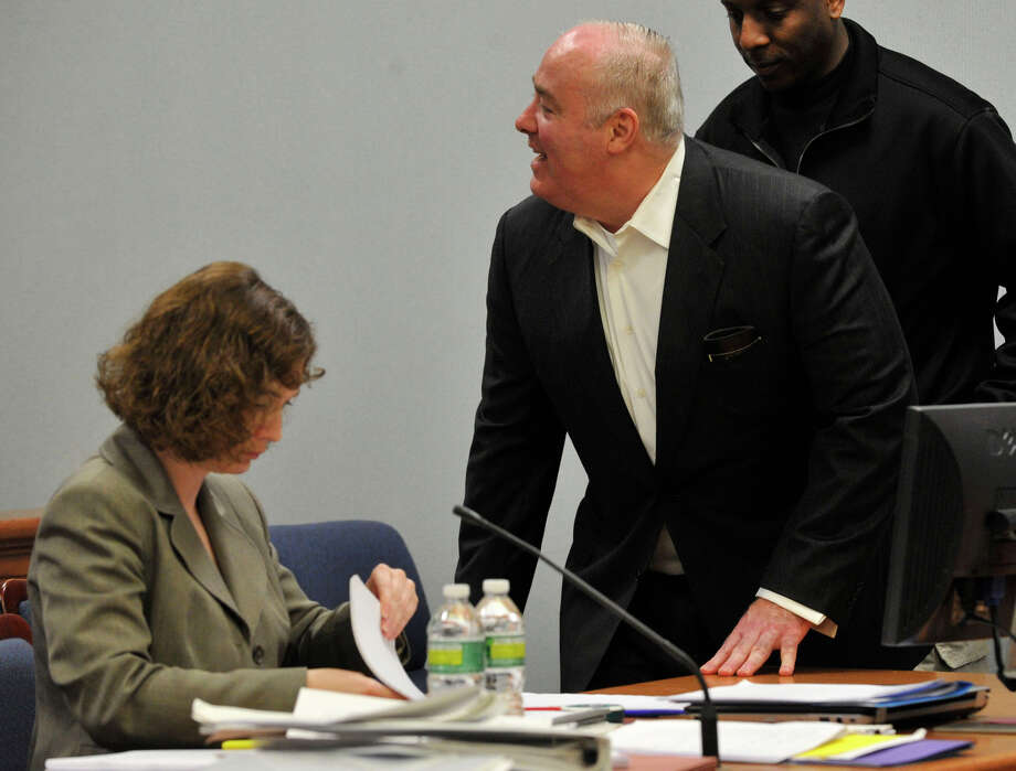 Michael Skakel returns to his seat and acknowledges his friends and family in attendance at his habeas corpus hearing at State Superior Court in Rockville, Conn., on Thursday, April 18, 2013. Photo: Jason Rearick / Stamford Advocate