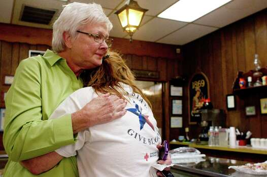 Dianne Friend, of West, hugs fellow resident Jamie Allnutt,  as Allnutt broke down talking about people who were missing in the fertilizer plant explosion. Photo: Johnny Hanson, Staff / © 2013  Houston Chronicle
