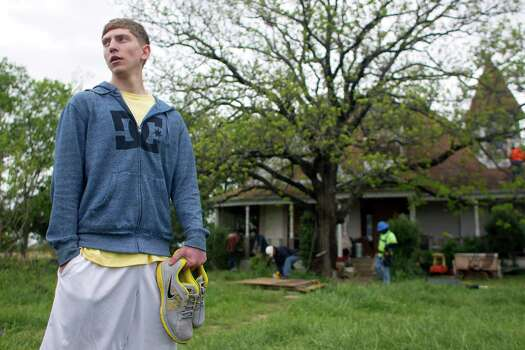 Zachery Kocain, 17, said he watched the explosion from his front yard, just more than 300 yards away. The blast caused all of the windows on his family's home to be blown out. Photo: Johnny Hanson, Houston Chronicle / © 2013  Houston Chronicle