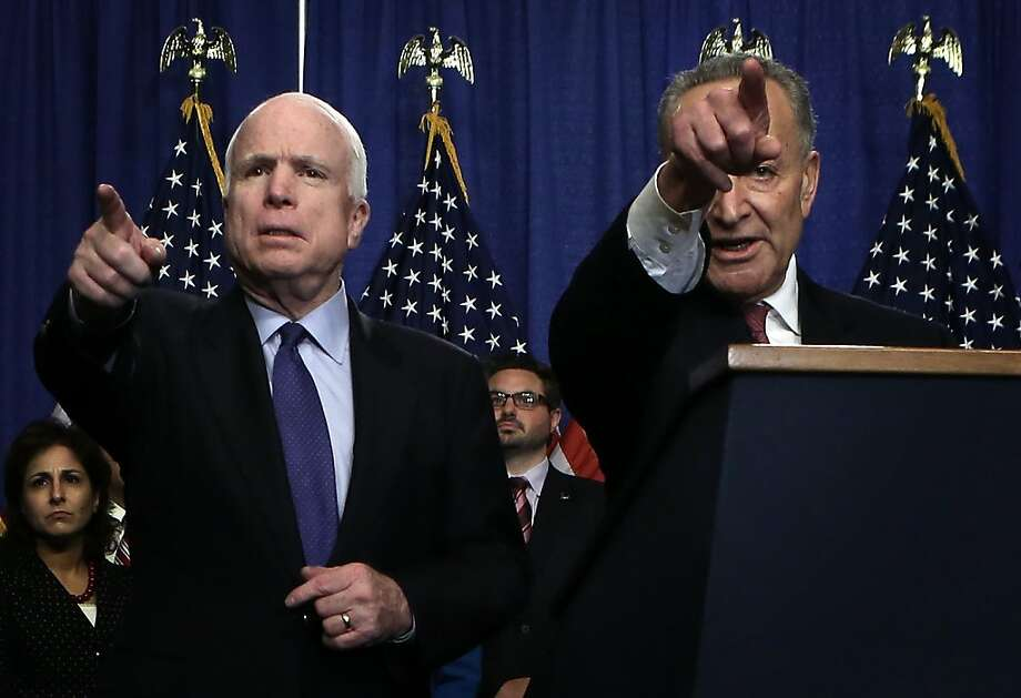 "WASHINGTON, DC - APRIL 18:  U.S. Sen. John McCain (R-AZ) (L) and Sen. Chuck Schumer (D-NY) take questions from members of the media during a news conference on immigration reform April 18, 2013 on Capitol Hill in Washington, DC. The senators discussed the ""Border Security, Economic Opportunity, and Immigration Modernization Act"".  (Photo by Alex Wong/Getty Images) Photo: Alex Wong, Getty Images"
