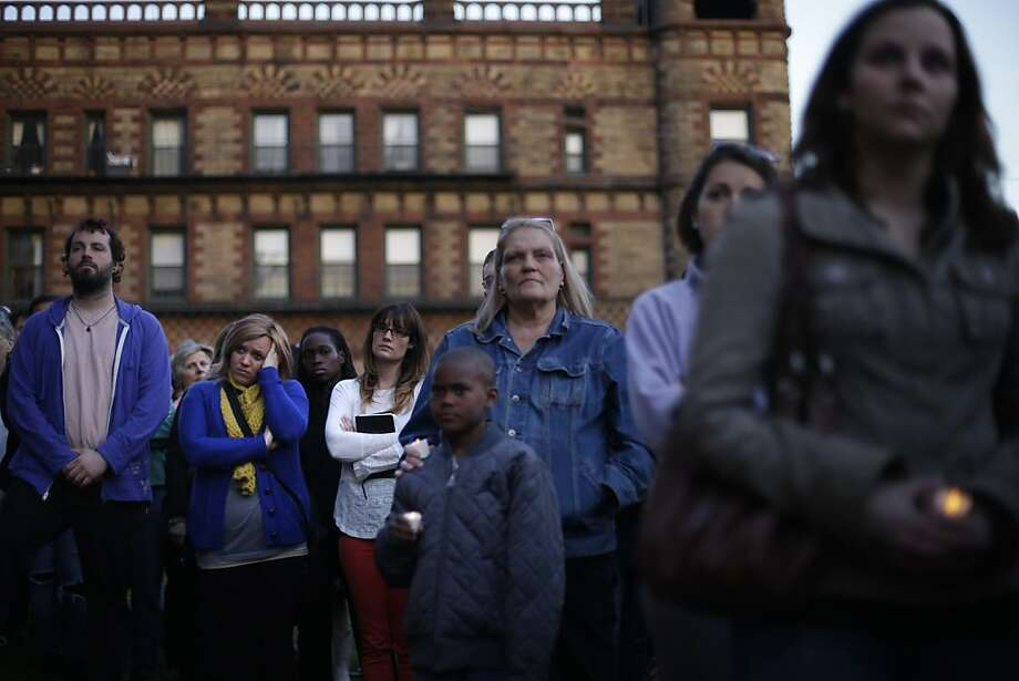 Mourners attend a candlelight vigil in the aftermath of Monday's Boston Marathon explosions, which killed at least three and injured more than 140, Wednesday, April 17, 2013, at City Hall in Cambridge, Mass. (AP Photo/Matt Rourke) Photo: Matt Rourke, Associated Press