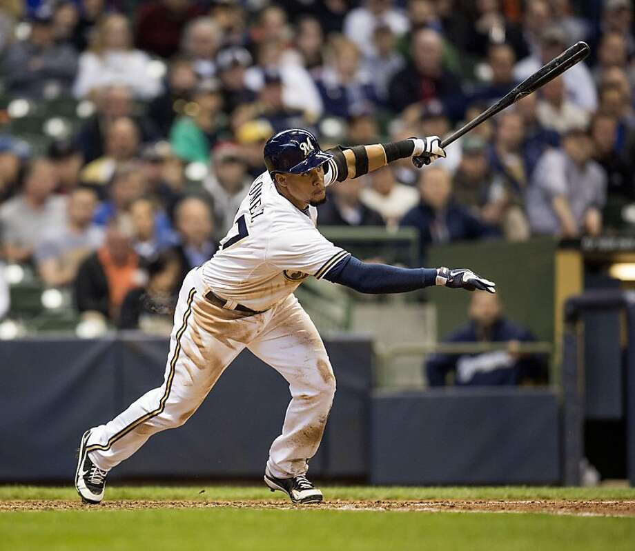 MILWAUKEE, WI - APRIL 18: Carlos Gomez #27 of the Milwaukee Brewers flies out to center against the San Francisco Giants in the sixth inning at Miller Park on April 18, 2013 in Milwaukee, Wisconsin.  (Photo by Tom Lynn/Getty Images) Photo: Tom Lynn, Getty Images