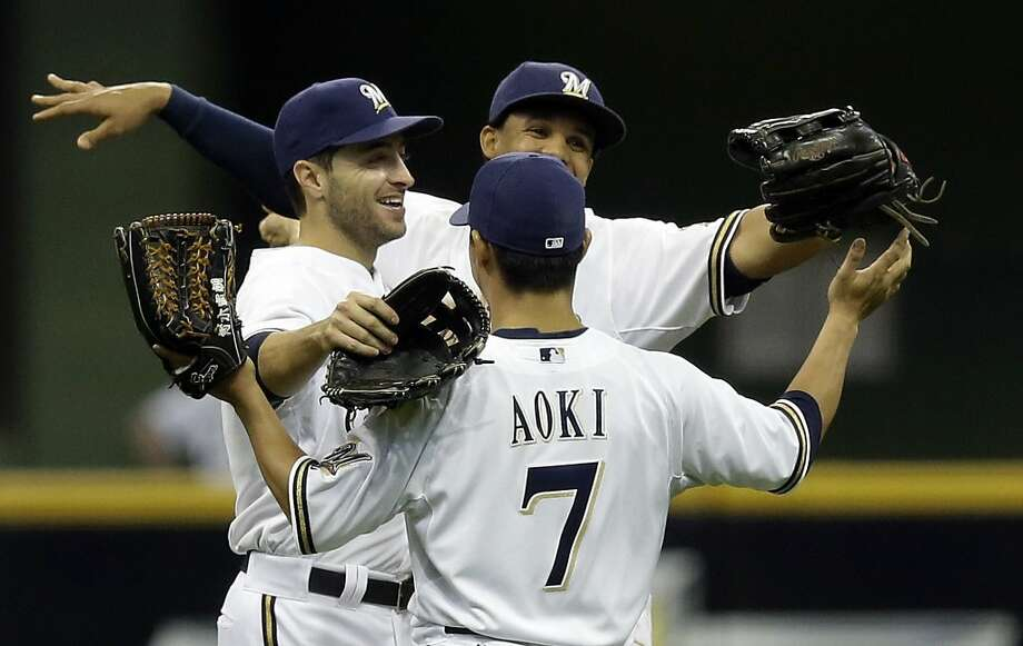 Milwaukee Brewers' Norichika Aoki (7) celebrates with Ryan Braun and Carlos Gomez, right, after a baseball game against the San Francisco Giants Thursday, April 18, 2013, in Milwaukee. The Brewers won 7-2. (AP Photo/Morry Gash) Photo: Morry Gash, Associated Press