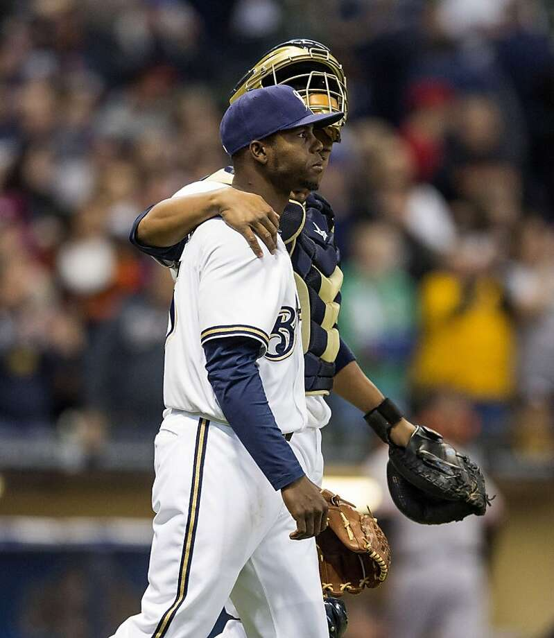 MILWAUKEE, WI - APRIL 18: Alfredo Figaro #45 and Martin Maldonado #12 of the Milwaukee Brewers walk off the field after defeating the San Francisco Giants 7-2 at Miller Park on April 18, 2013 in Milwaukee, Wisconsin.  (Photo by Tom Lynn/Getty Images) Photo: Tom Lynn, Getty Images
