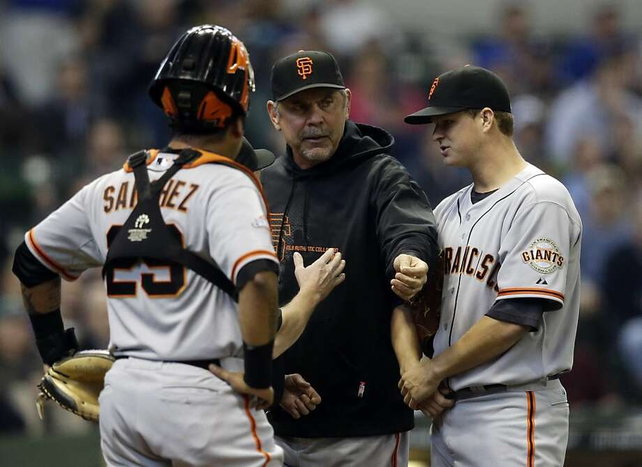 San Francisco Giants manager Bruce Bochy argues a call during the second inning of a baseball game against the Milwaukee Brewers Thursday, April 18, 2013, in Milwaukee. (AP Photo/Morry Gash) Photo: Morry Gash, Associated Press
