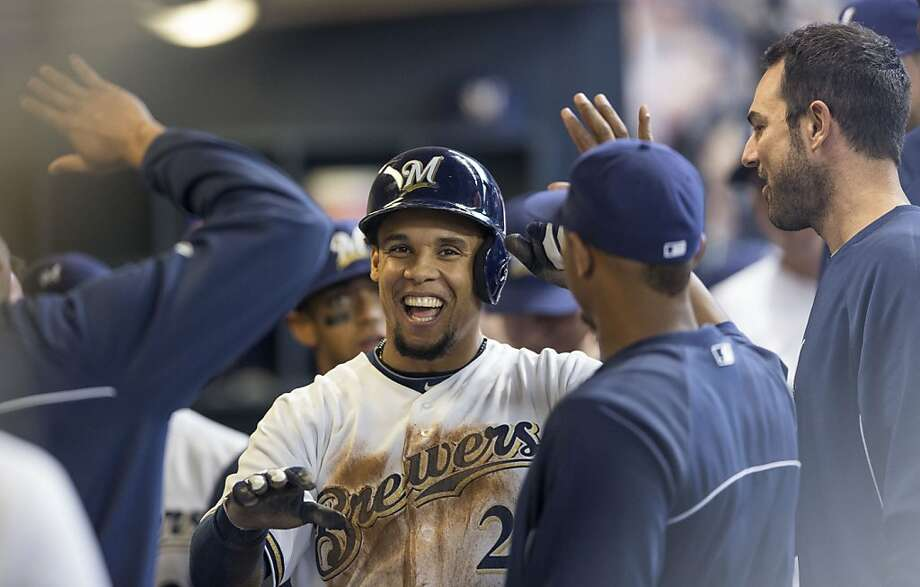 MILWAUKEE, WI - APRIL 18: Carlos Gomez #27 of the Milwaukee Brewers is greeted by teammates after scoring against the San Francisco Giants during the second inning at Miller Park on April 18, 2013 in Milwaukee, Wisconsin.  (Photo by Tom Lynn/Getty Images) Photo: Tom Lynn, Getty Images