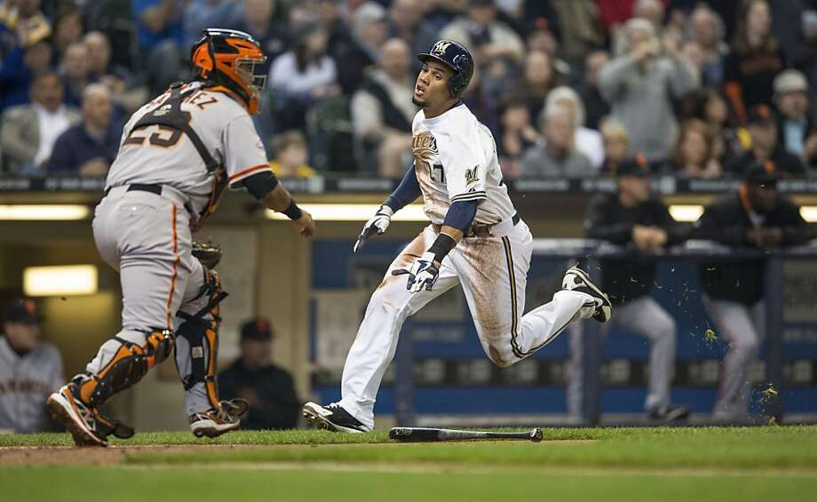 MILWAUKEE, WI - APRIL 18: Carlos Gomez #27 of the Milwaukee Brewers races past Hector Sanchez #29 of the San Francisco Giants to score during the second inning at Miller Park on April 18, 2013 in Milwaukee, Wisconsin.  (Photo by Tom Lynn/Getty Images) Photo: Tom Lynn, Getty Images