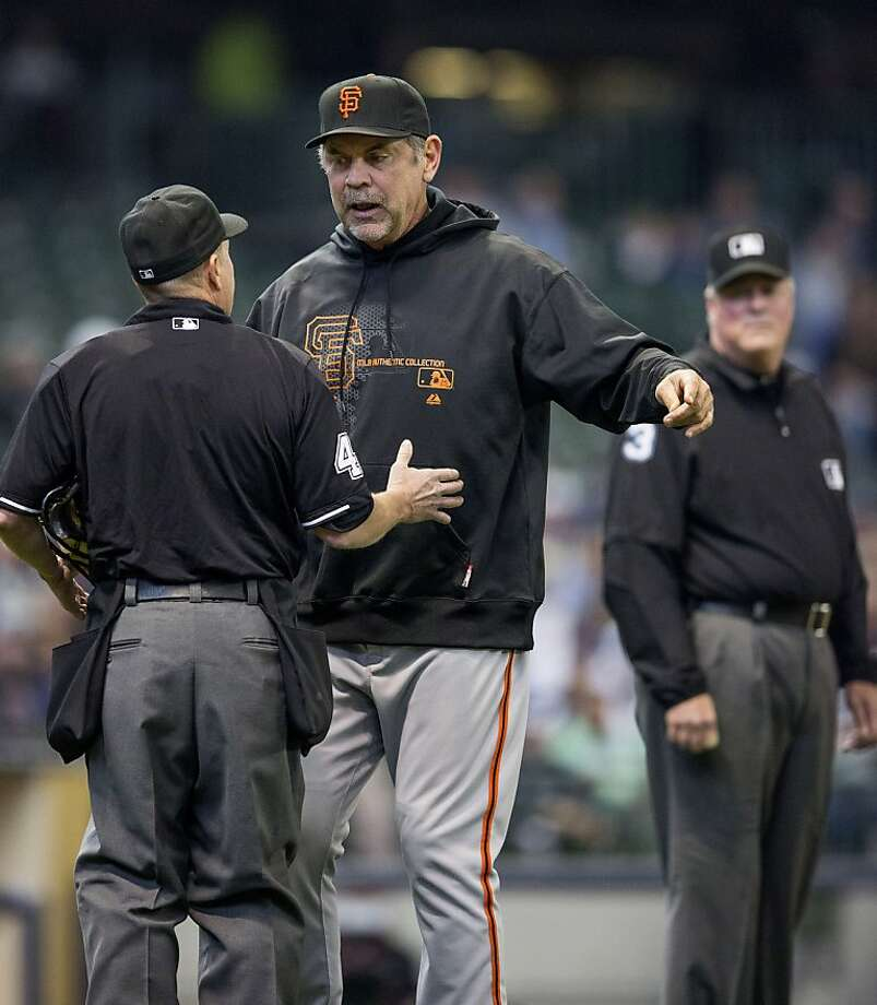 MILWAUKEE, WI - APRIL 18: Bruce Bochy #15 manager of the San Francisco Giants talks with home plate ump Jerry Meals #41 after Carlos Gomez #27 of the Milwaukee Brewers was hit with a pitch in the second inning at Miller Park on April 18, 2013 in Milwaukee, Wisconsin.  (Photo by Tom Lynn/Getty Images) Photo: Tom Lynn, Getty Images
