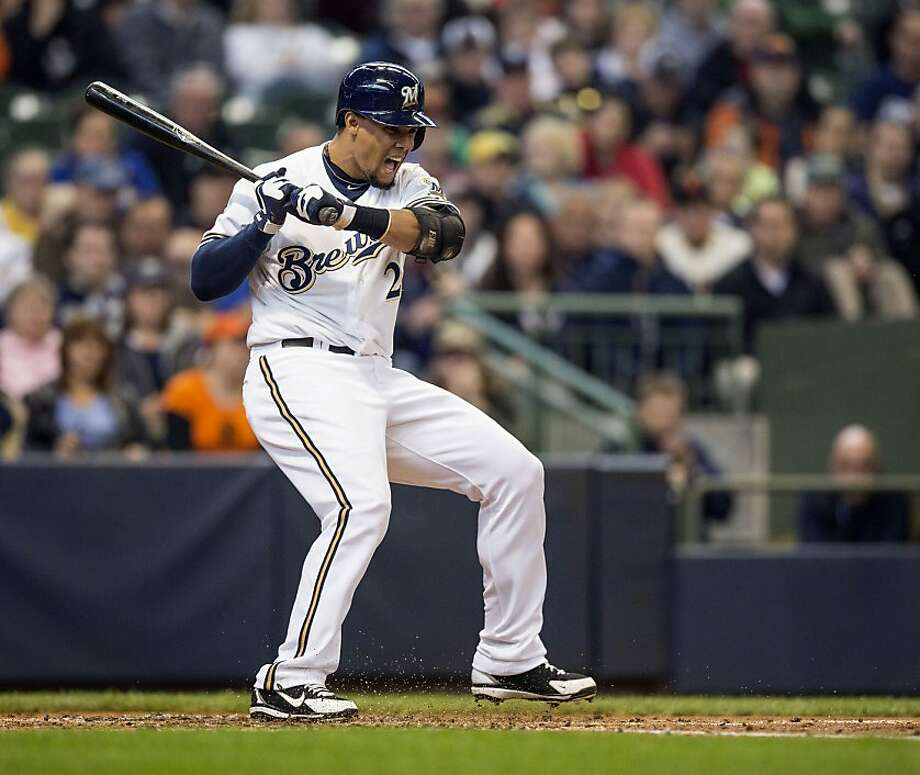 MILWAUKEE, WI - APRIL 18: Carlos Gomez #27 of the Milwaukee Brewers is hit with a pitch by Matt Cain #18 of the San Francisco Giants during the second inning at Miller Park on April 18, 2013 in Milwaukee, Wisconsin.  (Photo by Tom Lynn/Getty Images) Photo: Tom Lynn, Getty Images