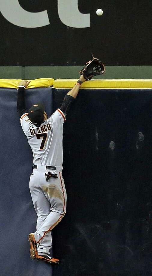 San Francisco Giants' Gregor Blanco can't come up with a two-run home run off the bat of Milwaukee Brewers' Yovani Gallardo during the second inning of a baseball game Thursday, April 18, 2013, in Milwaukee. (AP Photo/Morry Gash) Photo: Morry Gash, Associated Press