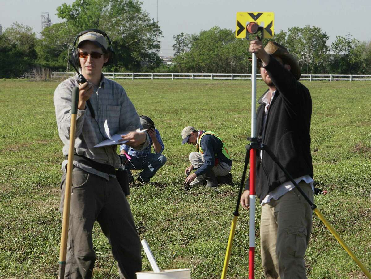 HRA Gray & Pape's David Treichel (from left), Tony Scott and William Fee work with metal detectors and survey equipment to search 98 acres at the San Jacinto battleground in LaPorte.