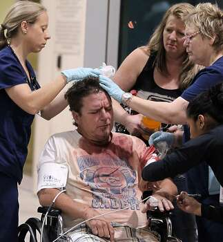 An unidentified man  injured by  the West fertilizer plant explosion is treated by nurses from Hillcrest Baptist Medical Hospital in Waco, Texas, Wednesday, April 17, 2013. (AP Photo/Waco Tribune Herald, Jerry Larson) Photo: Jerry Larson, Associated Press