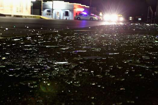 WEST, TX - APRIL 18:  Blown out plate glass windows lay shattered on the sidewalk and street after the West Fertilizer Company exploded April 18, 2013 in West, Texas. A massive explosion at the fertilizer company injured more than 100 people and left damaged buildings for blocks in every direction. The death toll from the blast, which occured as firefighters were tackling a blaze, is as yet unknown. (Photo by Chip Somodevilla/Getty Images) Photo: Chip Somodevilla, Getty Images