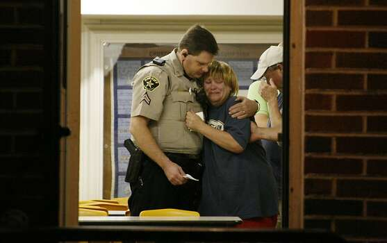 An unknown woman is consoled by a Sheriff's Deputy at a command post in West, Texas,U.S., on Thursday, April 18, 2013. An explosion at Adair Grain Inc.'s fertilizer facility in the town of West, Texas, killed as many as 15 people and injured at least 160 in what may be the worst U.S. industrial disaster since the Texas refinery blast in 2005. Photographer: Mike Fuentes/Bloomberg Photo: Mike Fuentes, Bloomberg